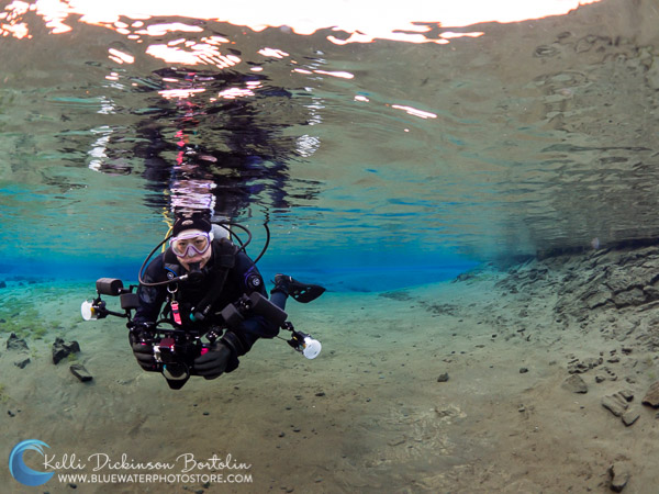 Carefully a diver fins across the shallow sandy lagoon. (ISO 250, F5.6, 1/500)
