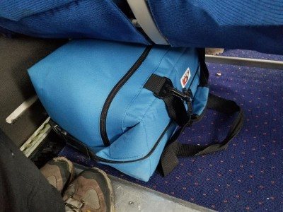 AO cooler bag fitting nicely under the small seat of the plane from Greenland.