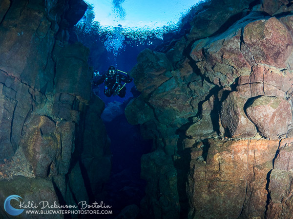 A diver cruises through the chasm between two tectonic plates (ISO 800, F5, 1/80)
